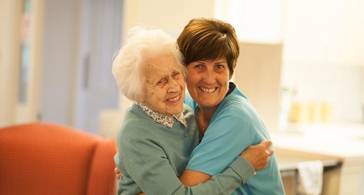 Carer Hugging Elderly